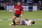 Robbie Fruean of the Crusaders breaks through the tackle of Francis Fainifo. Photo / Getty Images