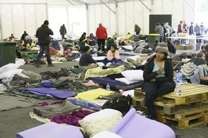 Christchurch's people left homeless gathered at the Civil Defence Emergency Centre in the immediate aftermath of the earthquake at Hagley Park. The park will host the memorial service on March 18. Photo / Mark Mitchell