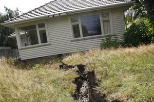 A house on Avonside drive in Christchurch after the February 22 earthquake. Photo / Sarah Ivey
