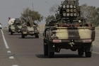 An advance by forces backing Libyan leader Moammar Gadhafi sent opposition fighters retreating from the strategic oil port of Ras Lanouf Thursday.