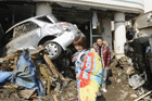 Vehicles were crushed by a collapsed wall at a carpark in Mito city, Ibaraki prefecture, after the massive magnitude 8.9 earthquake rocked Japan, unleashing a tsunami across the Pacific. Photo / AFP