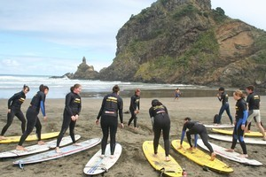 Surf students start out on the sands at Piha. Photo / Supplied