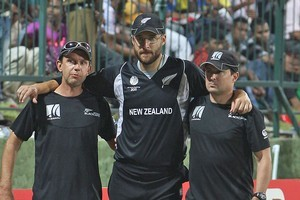 Daniel Vettori is helped off the field after injuring his knee against Pakistan. Photo / Getty Images
