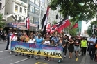 A hikoi against the new foreshore legislation marches peacefully down Auckland's Queen St today. Photo / NZPA