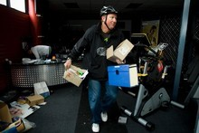 Elite Fitness owner Ian Kirk runs to get items from his shop when part of the Christchurch cordon was first lifted earlier this month. File photo / Dean Purcell