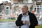 Structural Engineer Regan Potangaroa speaks outside a destroyed building near St Mary's Church on Manchester Street in Christchurch. Photo / Greg Bowker