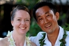 English teacher Jennifer Wadams Uzuki and husband Toru Uzuki, pictured here on their wedding day, had arduous journeys to be reunited. Photo / Supplied