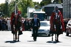 All Black captain Richie McCaw and two horsemen led the hearse down through a guard of honour after the funeral of Philip McDonald this afternoon. Photo / Sarah Ivey