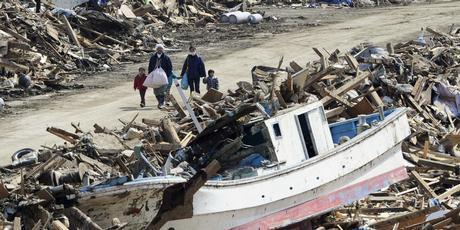 Residents walk through debris in Minami Sanriku, Miyagi. Photo / AP