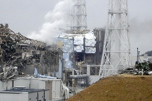 This picture taken yesterday shows extensive damage to two of the four reactors at the Fukushima nuclear power plant. Photo / AP