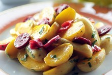 Potato saffron and chorizo salad. Photo / Doug Sherring 