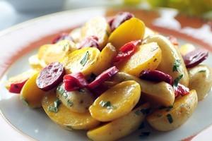 Potato saffron and chorizo salad. Photo / Doug Sherring