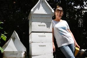 Kim Kneijber who calls herself a hobbyist, sells the honey she harvests at Birkenhead Market. Photo / Sarah Ivey