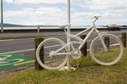 A bike placed in memory of cyclist Jane Bishop who was killed by a truck after swerving to avoid a car. Photo / Paul Estcourt