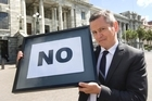 One News political editor Guyan Espiner with Winston Peter's famous NO sign. Photo / Mark Mitchell