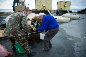The Army helps locals with fresh water from their fresh water plant at New Brighton in the days following the earthquake. Photo / Dean Purcell
