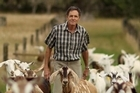 John Walter with his goats at his Crescent Dairy Goats farm in Kumeu. Photo / Supplied