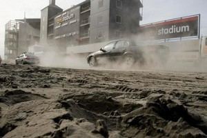 A dust bowl forms around AMI Stadium following the earthquake. Photo / Dean Purcell