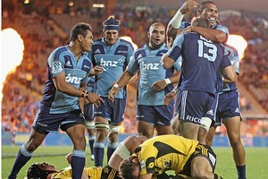 Jared Payne of the Blues is congratulated after scoring a try. Photo / Getty Images