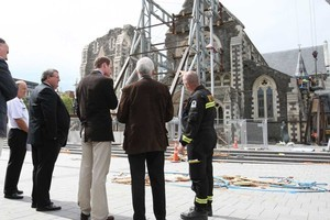 Prince William looks at the devastated Christchurch Cathedral with Earthquake Minister Gerry Brownlee, Dean Peter Beck and a USAR official. Photo / Pool coverage