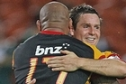 Mike Delany of the Chiefs (R) is congratulated by Sona Taumalolo (L). Photo / Getty Images