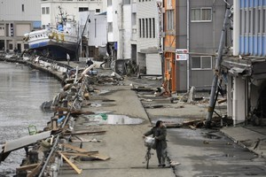 The aftermath in Ishonomaki, Miyagi prefecture. Photo / AFP