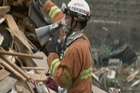 In a rare bit of good news, rescuers found two survivors Tuesday in the rubble left by the tsunami that hit the northeast, including a 70-year-old woman whose house was tossed off its foundation.