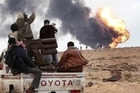 Libyan strongman Muammar Gaddafi's forces are bombarding rebel positions on the doorstep of Ajdabiya, a key town which the revolution against his rule has vowed to defend at all costs.