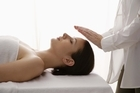 Reiki is a form of therapy which uses hands-on, no-touch and visualisation techniques to improve the flow of life energy in a person. Photo / Thinkstock