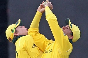 Ricky Ponting collides with team mate Steven Smith as he takes a catch. Photo / Getty Images