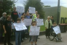 Protesters at Civil Defence HQ in Christchurch today. Photo / Sarah Ivey 