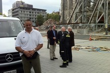 Prince William talks to Dean Peter Beck and a USAR official outside the Christchurch Cathedral. Photo / Fairfax