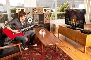 Rocksmith, for Xbox and PlayStation, uses real guitars, unlike the very popular Guitar Hero series.