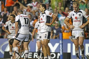 The Warriors look dejected after the West Tigers score a try. Photo / Getty Images