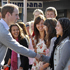 Publish Prince William meeting local girls during his walkabout in the Christchurch suburb of Sumner. Photo / Mark Mitchell