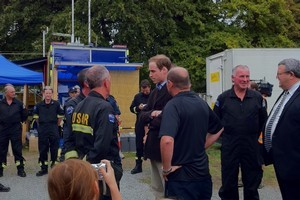 Prince William chats with USAR personnel in Christchurch today. Photo / Pool coverage