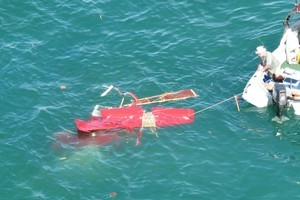 Wreckage from the plane after it plummeted into the ocean near Orewa. Photo / Westpac Rescue Helicopter