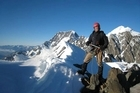Adam Parore on the south ridge of Mt Haidinger, with Mt Cook in the background. Photo / Supplied