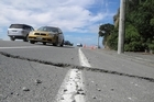A damaged road in Sumner. Photo / David Fisher