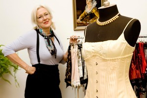 Jill Peterson, owner of Corseterie boutique in K Rd, with one of her wedding corsets. Photo / Babiche Martens