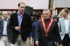 Prince William is escorted by Greymouth mayor Tony Kookshorn and Prime Minister John Key as he visits Greymouth. Photo / Mark Mitchell