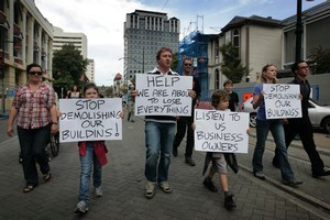 A group of protesters, comprised of central city business owners, land owners and other supporters, rallied together in support of their cause last week. Photo / Sarah Ivey