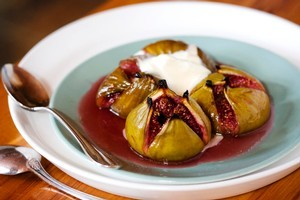 Sugar baked figs with orange syrup and cream. Photo / Babiche Martens