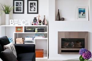 The living room's design gives it a modern, beachhouse feel. Photo / Your Hone & Garden