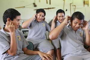 Ear-pulling song at Niue High School's cultural experience. Photo / Jim Eagles