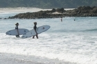 Surfers at Medlands Beach. Photo / Supplied