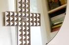 Studded cross. Photo / Babiche Martens