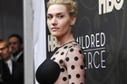 Academy Award winner Kate Winslet, who is no stranger to filming nude scenes, helped co-star Evan Rachel Wood through her very first shoot in the buff in their new HBO miniseries, 'Mildred Pierce.'