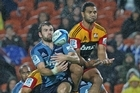 Jared Payne of the Blues (L) and Lelia Masaga of the Chiefs contest for the high ball. Photo / Getty Images