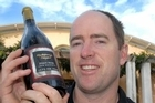 Martinborough Vineyard winemaker Paul Mason with a bottle of their 1998 Reserve pinot noir. Photo / Lynda Feringa